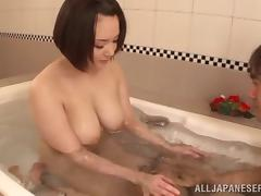 Fondling big natural Japanese tits in the bathtub gets him hard