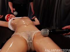 Tied down and blindfolded Japanese slut oiled up and played with