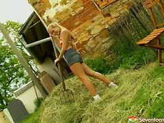 Cute farm girl takes a break to masturbate in a pile of hay