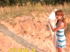 Russian babe shows pink on the fine sand