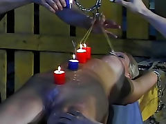 Hot wax covers her submissive body