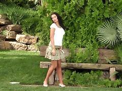 Sexy brunette babe masturbating in an exotic garden