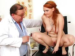 Milf redhead in medical fetish video