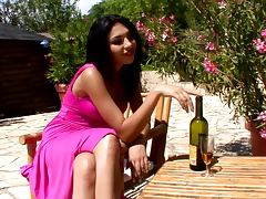 Alison fucks her snatch with a bottle in the garden