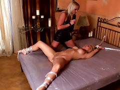 Britney is penetrating mouth with Kathia Nobili with strapon