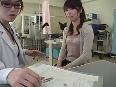 Skinny Jap babe gets banged with a dildo during Gyno exam