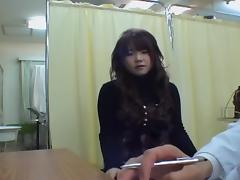 Lovely Asian babe gets her cunt checked during medical exam