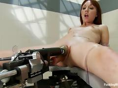 Slim redhead babe gets her tight pussy drilled by a machine