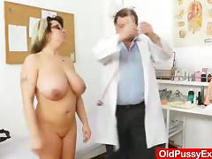 This MILF has some seriously big natural tits and it is insertion time as she hits the exam table