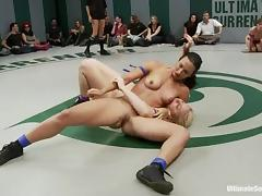 Nude chicks wrestle in a ring and finger their pussies